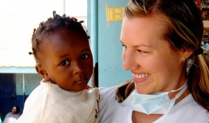 Sonja Sproul, Eugene female dentist, with a child